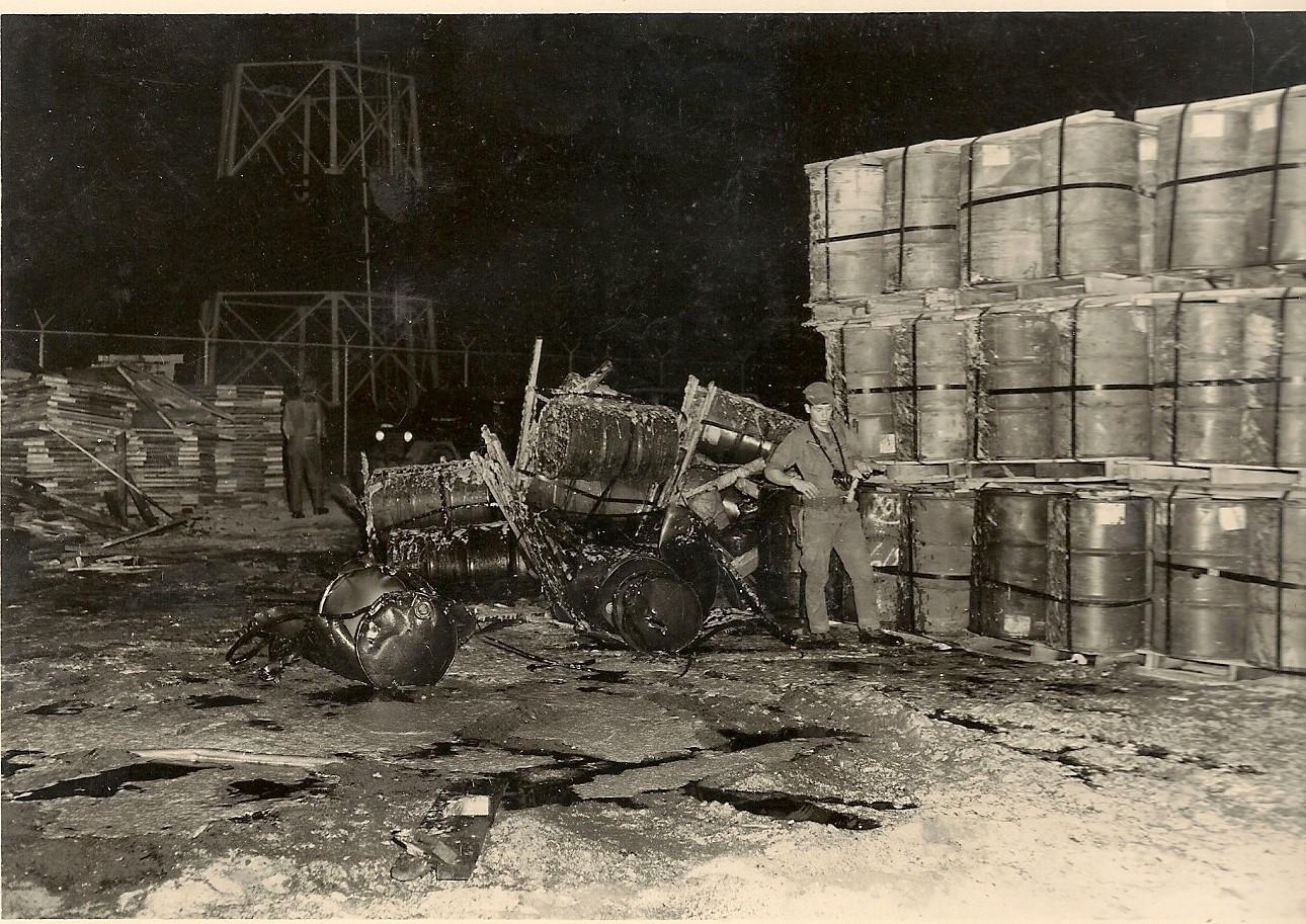 Barrels of asphalt damaged by rocket attack