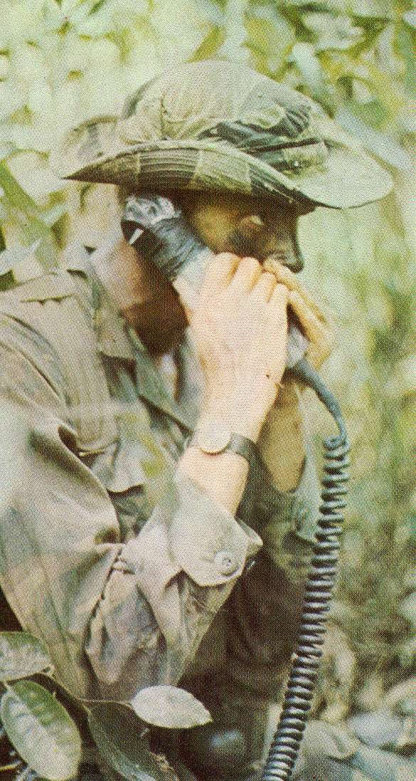 """Unknown soldier talking on a field phone. There were no """"cell phones"""" then."""
